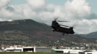 Panning shot following a CH-47 Chinook Helicopter.