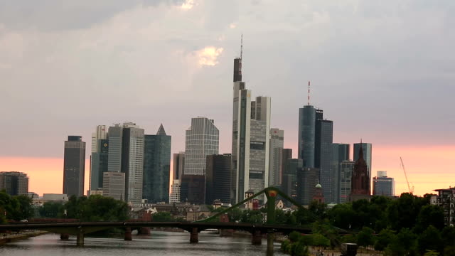 Panning shot Frankfurt Cityscape along the main river sunset