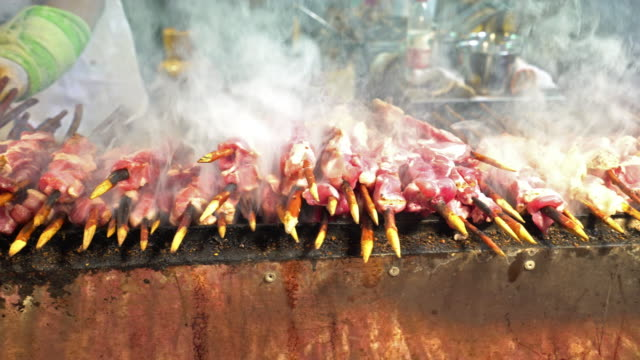 Panning shot: goat and lamb meat BBQ in Chinese style in Xian China