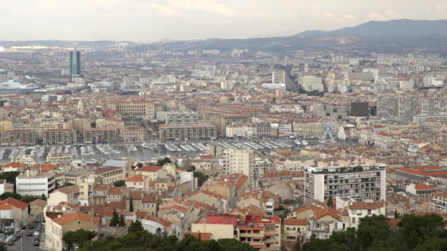panning shot of Aerial Marseille city with old Vieux Port