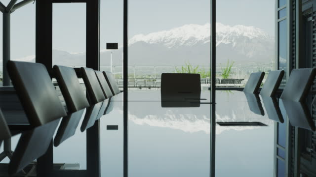 Panning shot of conference room with mountains in background / Provo, Utah, United States,