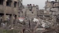 Panning shot of destroyed buildings in Aleppo