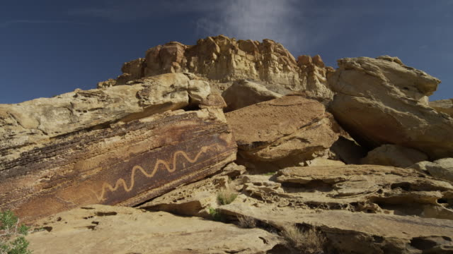 Panning shot of drawing on rock formation at San Raphel Swell,  / San Raphel Swell, Utah, United States,
