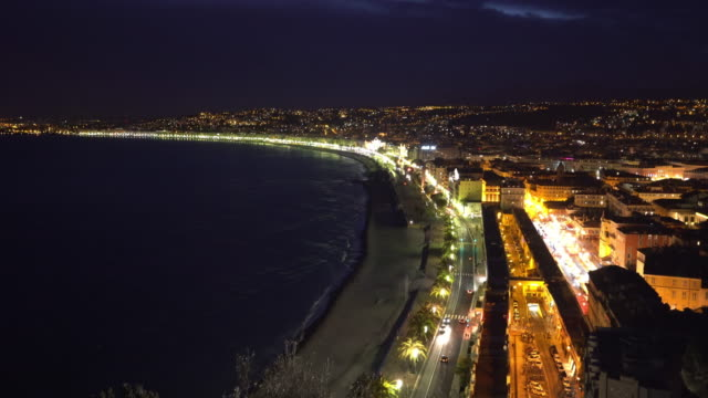 Panning shot of Nice Beach Harbour French Riviera France night