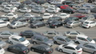 Panning shot of Parking lot full of cars