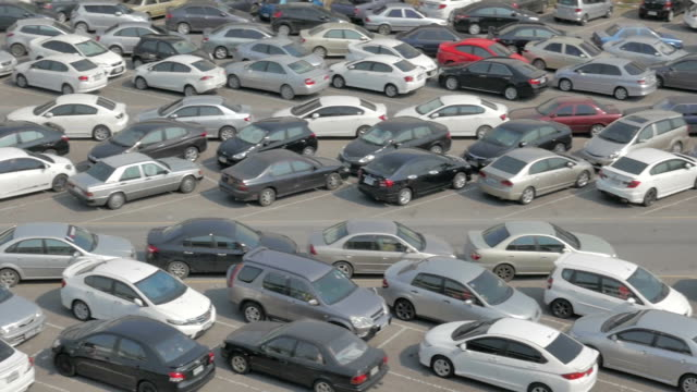 Panning shot of Parking lot full of cars