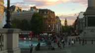 Panning shot of Trafalgar Square with Big Ben in the distance.