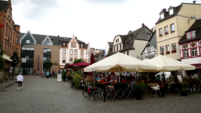 Panning shot: Pedestrian crowded at Boppard Town square Germany