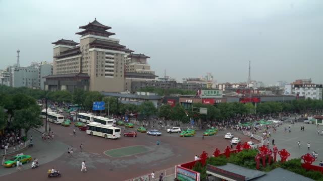 Panning shot: Pedestrian crowded at Xian Train station square Xian China