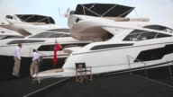 Panning Shot people look at the various types of boats for sale on the opening day of the annual PSP Southampton Boat Show on September 13 2013 in...