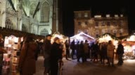Panning Shot shoppers walk around the various stalls at the Bath Christmas Market on its opening night on November 28 2013 in Bath England...