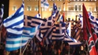 Panning Shot supporters of the ultranationalist party Golden Dawn demonstrate outside parliament on November 30 2013 in Athens Greece The Golden Dawn...