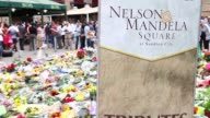Panning Shot thousands of mourners leave flowers at Nelson Mandela Square on December 7 2013 in Johannesburg South Africa Mourners have been...