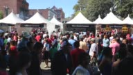 """Panning Shot thousands of people buy Mexican mole sauce dishes while attending the """"Feria de los Moles"""" at la Placita park in downtown Los Angeles"""