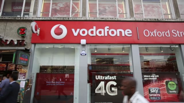 Panning Shot Vodafone shop on Oxford Street Vodafone has agreed to sell it's 45 percent stake in Verizon Wireless for $130 billion
