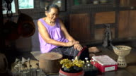 panning: Thai grandmother in her old-fashion house