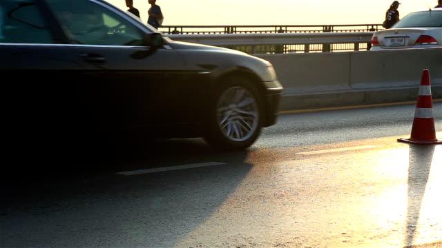 HD Panning: Traffic on bridge in evening.