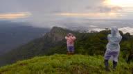 panning: traveler in rain season on the mountain peak