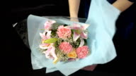 panning : women arrange wedding bouquet