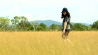 panning: young woman feeling happy on Savannah field