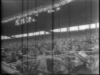 Panorama of the stands at Wrigley Field in Chicago Illinois / football players run out of dugout in uniform / spectators in stands at Wrigley Field /...