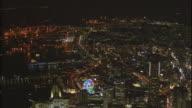A panoramic night view of Yokohama Minato Mirai 21 area with lighted Ferris wheel