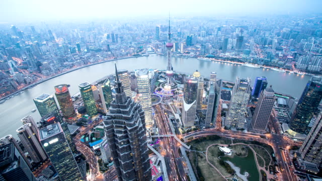 Panoramic skyline,buildings and traffics from day to night in Shanghai, time lapse.