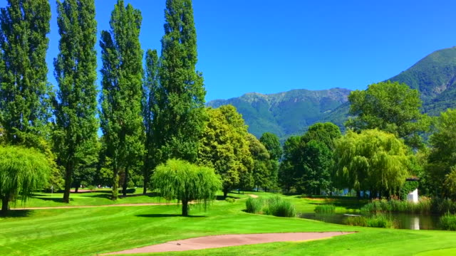 Panoramic View Over Golf Club Ascona in a Sunny Day with Alpine Lake and Mountain in Ticino Switzerland