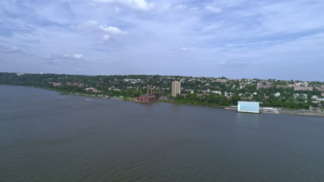 Panoramic view to Yonkers, New York State, over the Hudson river. Include the New York Central Railroad - Power Plant. Aerial drone video.