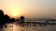 panoramic waterscape of west lake during sunset