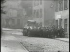 Panzer tank moving forward passing DANZIG Soldiers use panzerkampfwagen as cover Explosion outside post office Nazi soldier spraying accelerant EXT...