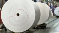 MS Paper rolls on trolleys at printing plant, San Francisco, California, USA / AUDIO