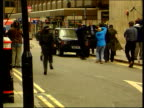 Papers sale blocked LIB ENGLAND london EXT Former Cabinet Minister Jonathan Aitken from car LMS Photographers surrounding Aitken as police move...