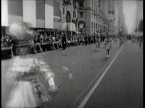 parade for Columbus Day / baton twirlers marching / spectators watching parade / boy playing a drum