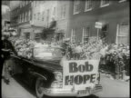 Parade in celebration of the 22nd Shenandoah Apple Blossom Festival / Float goes by on the street surrounded by onlookers / Grand Marshall Bob Hope...