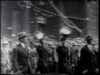 Parade moving down Manhattan street USN Commander Richard Byrd Jr walking w/ uniform hat raised Crowd watching TRACKING Byrd amp pilot Floyd Bennett...