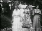 B/W 1929 parade of women in 19th century dress / Pasadena, California / newsreel