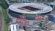 Air views AIR TO AIR Police helicopter in flight over the Emirates Stadium / AIR VIEWS / AERIALS Emirates Stadium as fans mover away at end of...