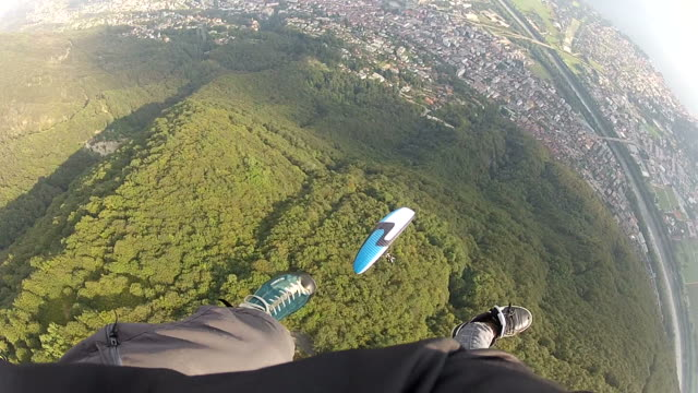POV paraglider descending in mid air