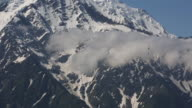 Paragliders descending from the French Alps down to Chamonix.
