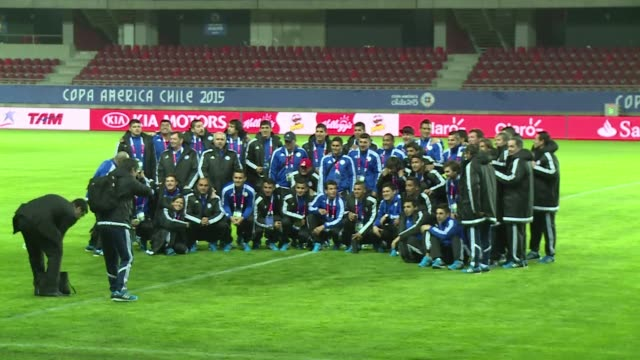Paraguay's national team does an onfield recognition before facing Argentina on their first Copa America game Saturday