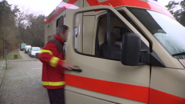 MS Paramedic getting into ambulance / Berlin, Germany