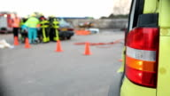 Paramedic with ambulance on a car crash.