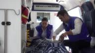 Paramedics attending an unconscious patient