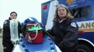 MS Paramedics rolling stretcher down hill to reach victim, New London, Wisconsin, USA