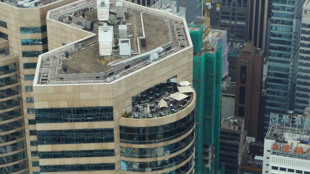 Parasols opened on Large High Rise Balcony in Hong Kong Island