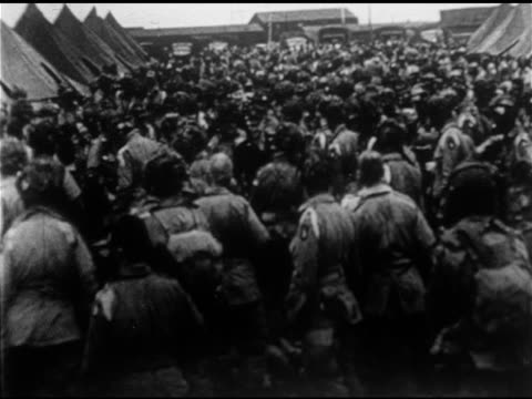 Paratroopers at Greenham Common Airfield England w/ General Dwight D Eisenhower walking down through infantry MS Talking w/ blackened face 101st...
