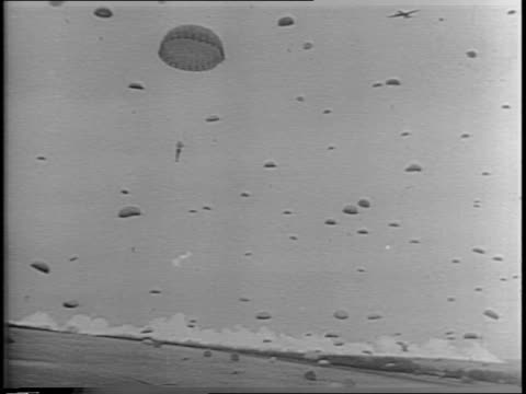 Paratroopers jumping from planes / RAF Marshall Arthur Tedder General Dwight D Eisenhower and Field Marshall Bernard Montgomery looking on /...