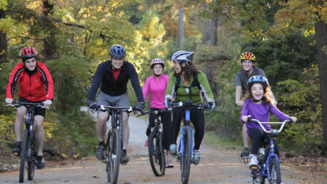 TS Parents and Children Riding Bikes Together on Path in Woods / Richmond, Virginia, USA