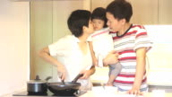 HD : Parents and Daughter in kitchen